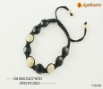Om Bracelet with Onyx in Gold only at Rs. 58000